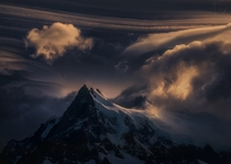 For Eternity Lenticular wave clouds over the peak of Cerro Grande Patagonia Argentina  Photo by Marc Adamus