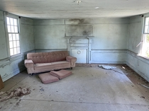 Forgotten couch in a long-abandoned farm house in rural North Carolina