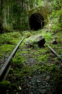 Forgotten train tracks and tunnel on the outskirts of Tokyo