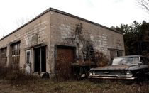 Former garage with forlorn Oliver tractor and  Ford Galaxie Hoosick NY