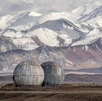 Former Soviet listening post in Sary Tash Kyrgyzstan now a refuge for sheep by Samuel Gunter