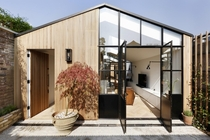 Former timber shed turned into a two-bedroom house clad in Western Red Cedar London UK by De Rosee Sa Photo Alex James