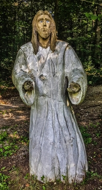 Found an interesting hand carved wooden Jesus statue in the driveway of an abandoned house
