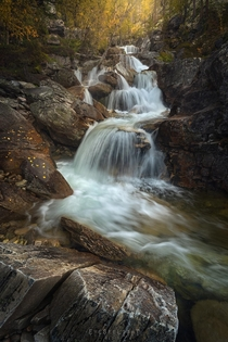 Found multiple cascades in a forest full of fairytale autumn mood Oppland Norway