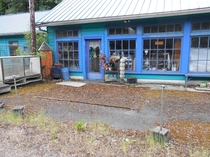 Found on Route  in Oregon I think it was a single pump gas station at one time and was turned into an antique shop before being abandoned More pics in comments Thats a carpet on the ground with moss covering it