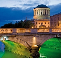 Four Courts and bridge over the River Liffey Dublin Image - Sean Caffrey