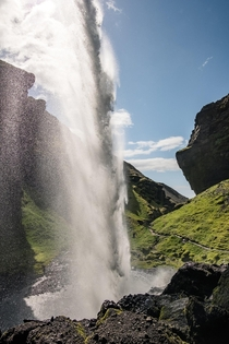 From behind Kvernufoss waterfall in south Iceland