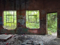From inside a solitary brick building near a train track in Amherst Massachusetts