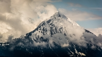 From Interlaken The Swiss Pyramid Niesen in clearing clouds