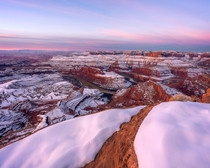 From one of those rare times the canyons near Moab Utah get covered in snow showing off the contrast between red amp white Dead Horse Point during a brisk February sunrise  morgantuohy