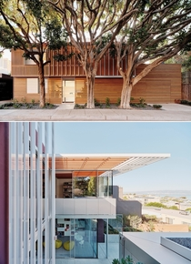 Front and rear faade of a residence with glass pavilion and aluminum trellises San Francisco California by Fougeron Architecture Photo Joe Fletcher