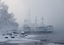 Frost-covered boats on the Yenisei River Siberia  Photo by Marina Fomin