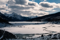 Frozen river flowing through Medicine Lake in Jasper National Park surrounded by a forest burned by fire Couldnt hear any sounds for miles