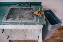 Frozen Sink Water left running in an abandoned health center