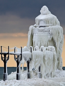 Frozen spray St Joseph North Pier Outer Lighthouse on Lake Michigan