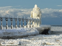 Frozen St Joseph North Pier Lighthouse in St Joseph Michigan  Info in comments