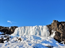 Frozen waterfall Thingvellir National Park Iceland x