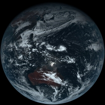 Full disk true-color image of Earth taken by Himawari- the Japanese weather satellite launched in October