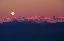 Full moon over the Alps near Turin Italy  by Stefano De Rosa