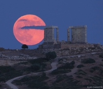 Full Moon over the temple of Poseidon the  year-old ancient temple in Cape Sounion Credit Elias Chasiotis