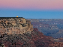 Full moon sets at sunrise  Grand Canyon