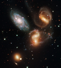 Galactic Wreckage in Stephans Quintet this image reveals a wide range of stars taken by the Hubble Space Telescope in visible and near-infrared light