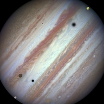 Galilean moons Europa Callisto and Io pass in front of Jupiter Photo of this rare triple-moon conjunction taken by the Hubble Space Telescope
