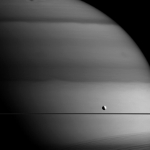 Gas giants are called giants for a reason This photo shows just a sliver of Saturn and its size compared to the tiny moon Dione This image shows how thin Saturns rings are when seen edge-on If you peek toward the bottom you will see a shadow cast by the r