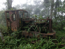 Gasoline-powered Kato Works locomotive left behind in the woods