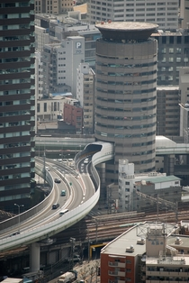 Gate Tower Building With a Highway Through it Osaka Japan