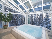 Getting into the Jacuzzi and watching it snow outside