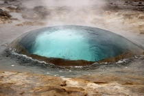 Geyser in Strokkur Iceland seconds before eruption