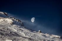 Gibbous Moon beyond Swedish Mountain