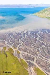 Glacial river flowing into the Westfjords of Iceland  isleyreust