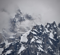Glacier covered peaks emerge from the clouds in the Alaska Range