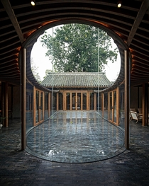 Glass enclosed courtyard in Qishe Courtyard a renovated traditional residence centered around courtyards in the old quarter of Beijing China