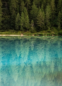 Glass-like reflections in Lago di Sorapis Italy