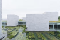 Glenstone Museum in USA is designed by Thomas Phifer and Partners in collaboration with facade consultant Heintges It consists of a single interconnected structure built of gargantuan precast concrete blocks semi-submerged into the landscape and illuminat