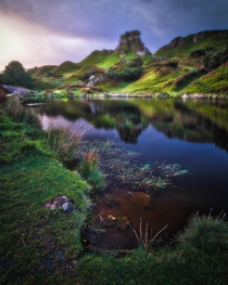 Glorious sunrise light on Castle Ewen in the Fairy Glen Isle of Skye Scotland