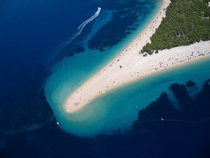 Golden cape a narrow white pebble beach in Croatia The shape of the beach shifts with the changes in tide currents and wind