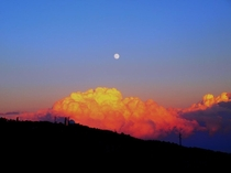 Golden clouds and full moon sunset at Crimean Peninsula Photo taken by Sugar Bee