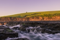 Golden Hour Hill Gerringong NSW Australia Where the ocean meets the mountains is a very special place The beautiful rolling greens hills surround the ocean here and Ive always tried to capture it just like this image Very stoked  IG  jyeberryphoto