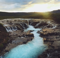 Golden sun at pm over the crystal waters of Brarfoss - Iceland