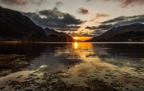 Golden sunset over Loch Schiel in the Scottish Highlands UK