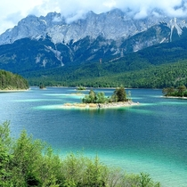 Gorgeous view of Eibsee Lake under Zugspitze Germanys tallest mountain OC