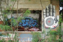 Graffitied building with broken red piano on Oahus North Shore
