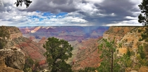 Grand Canyon  OC - rain falling on the Grand Canyon south rim view Amazing place Please make sure you visit it at least once in your lifetime