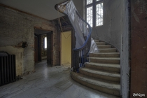 Grand Staircase Inside an Vacant Tudor Revival Mansion That is Being Saved