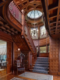 Grand staircase with intricate woodwork and wall panelling in a restored  Queen Anne Victorian mansion Plainfield Union County New Jersey