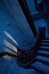 Grand stairwell inside an  insane asylum in upstate New York by the light of the full moon